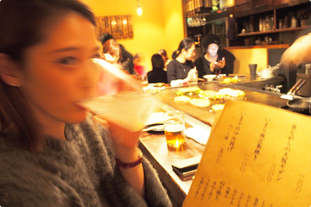 I am showing the menu to Mayuko.