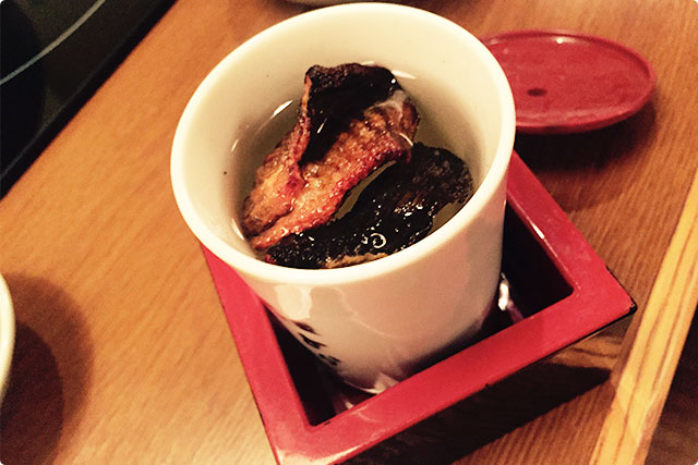 This drink is called 'Hire-zake'. It is a hot sake with grilled fish fins